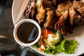 picture of blubber  - baked pork belly with garlic at restaurant - JPG