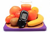 pic of immune  - Glucose meter fresh ripe natural fruits and glass of juice on cutting board concept for diabetes healthy nutrition and strengthening immunity - JPG