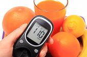 pic of immune  - Hand with glucometer fresh ripe natural fruits and glass of juice concept for diabetes healthy nutrition and strengthening immunity - JPG