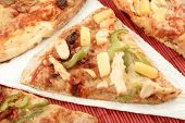 picture of doughy  - slices of pizza with different types of toppings - JPG