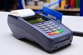 picture of terminator  - Payment terminal with credit card on desk in store credit card reader payment terminal finance concept - JPG