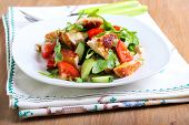 stock photo of rocket salad  - Chicken breast rocket cucumber and tomato salad with citrus dressing - JPG