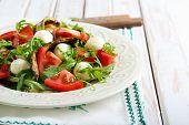 picture of rocket salad  - Zucchini mozzarella tomato and rocket salad on plate - JPG