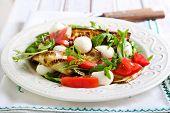 stock photo of rocket salad  - Zucchini mozzarella tomato and rocket salad on plate - JPG