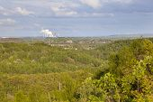 foto of slag  - View from a slag heap over green forest in west Germany near Aachen to a distant coal - JPG