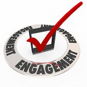 foto of check  - Engagement word on a ring around a check mark and box to illustrate keeping an audience or customers engaged in messaging or interaction - JPG