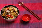 stock photo of clam  - herbal clam soup Vietnam style served on a place mat - JPG