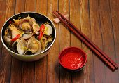 pic of clam  - herbal clam soup Vietnam style served on a wood table top - JPG