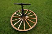 picture of stagecoach  - A wooden wheel for a carriage is having the hub glued under pressure from an old clamp - JPG