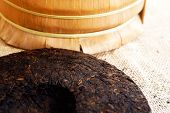 stock photo of briquette  - Chinese Puer tea pressed into rounded briquettes - JPG