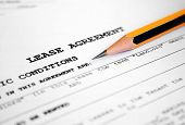 picture of rental agreement  - Close up of pencil on Lease agreement - JPG