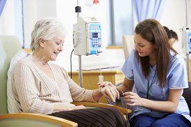 pic of chemotherapy  - Senior Woman Undergoing Chemotherapy With Nurse - JPG