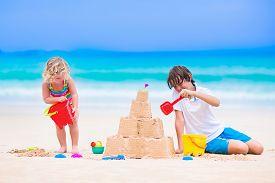 pic of spade  - Kids playing on a beach - JPG