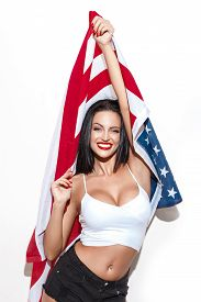 image of independent woman  - Sexy brunette woman with usa flag star spangled banner independence day 4th july - JPG