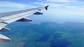 image of aeroplan  - Aerial view from airplane airplane with beautiful sky - JPG