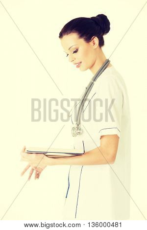 Attractive medicine student or doctor with book