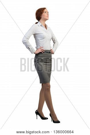 Full lenght image of young confident businesswoman on white background