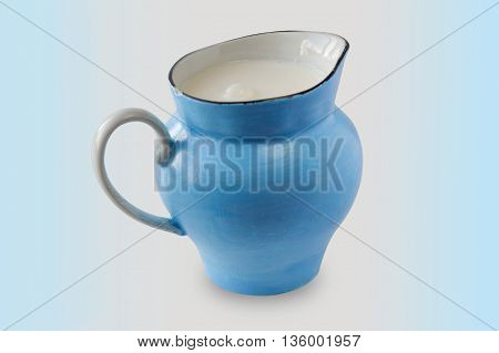 Jug of milk. Vintage old blue jug.