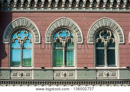 ancient architecture building with three windows in classic style.