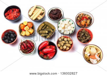 Pickled cucumber, onion, olives and vegetables isolated on white background