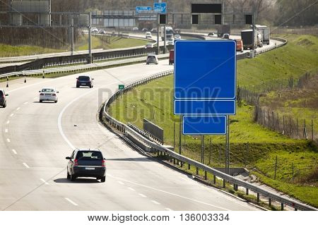 Highway with cars passing by