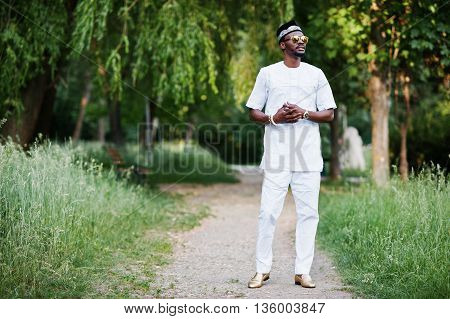 Portrait Of Stylish And Rich Black African American Man On White Clothes, Sunglasses And Hat