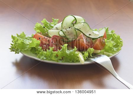 salad with tomatoes and cucumbers in a plate.