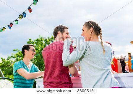 Couple on garden party enjoying the celebration