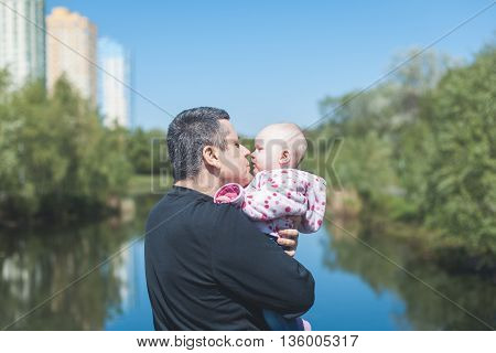 Father holding and hugging his little daughter
