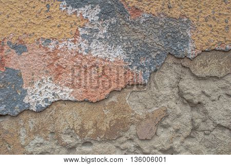 old chipped plaster on the concrete wall, grunge concrete surface, great background or texture
