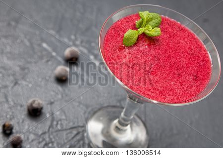 red smoothie with frozen berries selective focus top view. the detox concept.