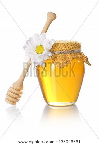 Honey jar with honey dipper on white background