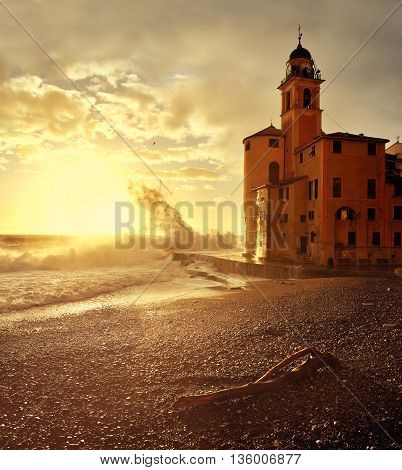 Big waves at sunset on the seafront Camogli