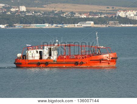 Gelendzhik Russia - September 8 2010: Rescue boat with its crew on deck on patrol at the harbor