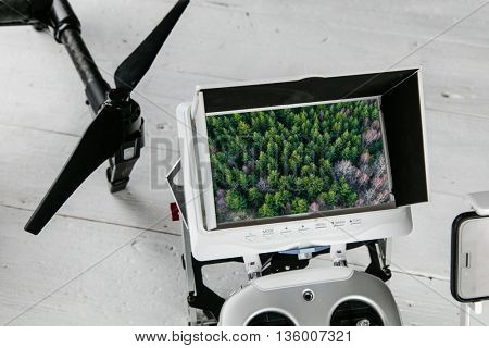 Drone aerial photography concept - Radio control transmitter with monitor, close-up.