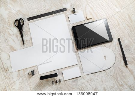 Photo of blank stationery set and corporate identity template on light wooden background. Responsive design template. Mock-up for branding identity. Blank template for your design.