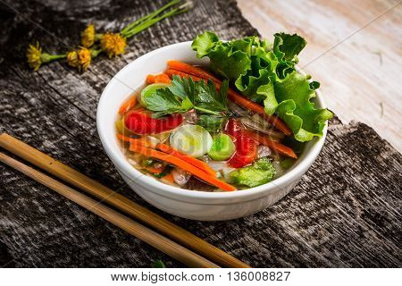 Bowl Of Thai Soup With Fresh Ingredients