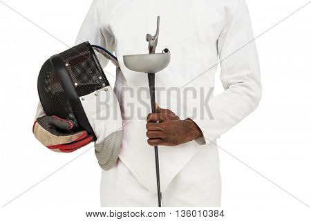 Mid-section of man standing with fencing mask and sword on white background