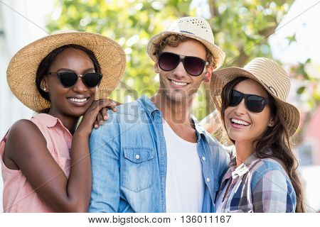 Friends in sunglasses posing at camera