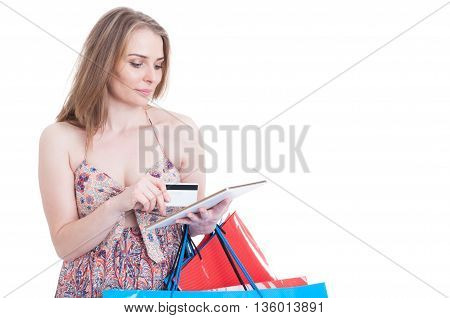 Pretty Modern Woman Browsing On Internet And Paying With Card
