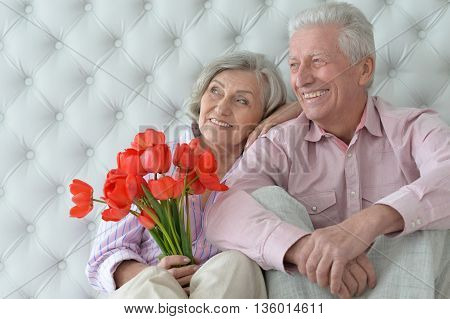 portrait of happy  Mature couple with poppies