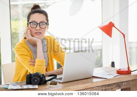 Hipster sitting in front of a laptop in the office