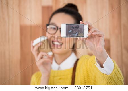 Hipster taking a selfie on wooden background