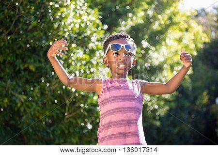 Boy wearing sunglasses in a park
