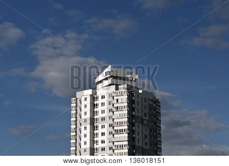 Modern Residential Building Against Blue Sky With Clouds.