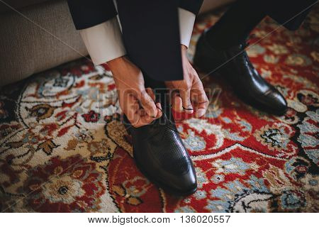 Men wearing work black boot. returning to the house