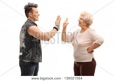 Punk rocker and his grandma doing a high five isolated on white background