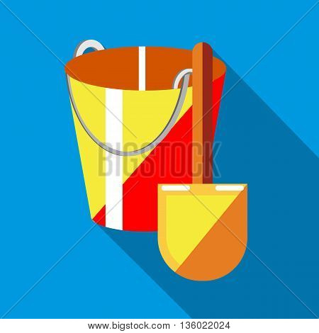 Bucket and shovel for childrens sandbox icon in flat style on a sky blue background