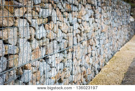 Wire Gabion Rock Fence. Metal Cage Filled With Rocks.