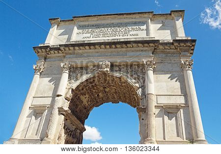 The Arch of Titus at Forum Roman bottom-up view over blue sky background Rome Italy